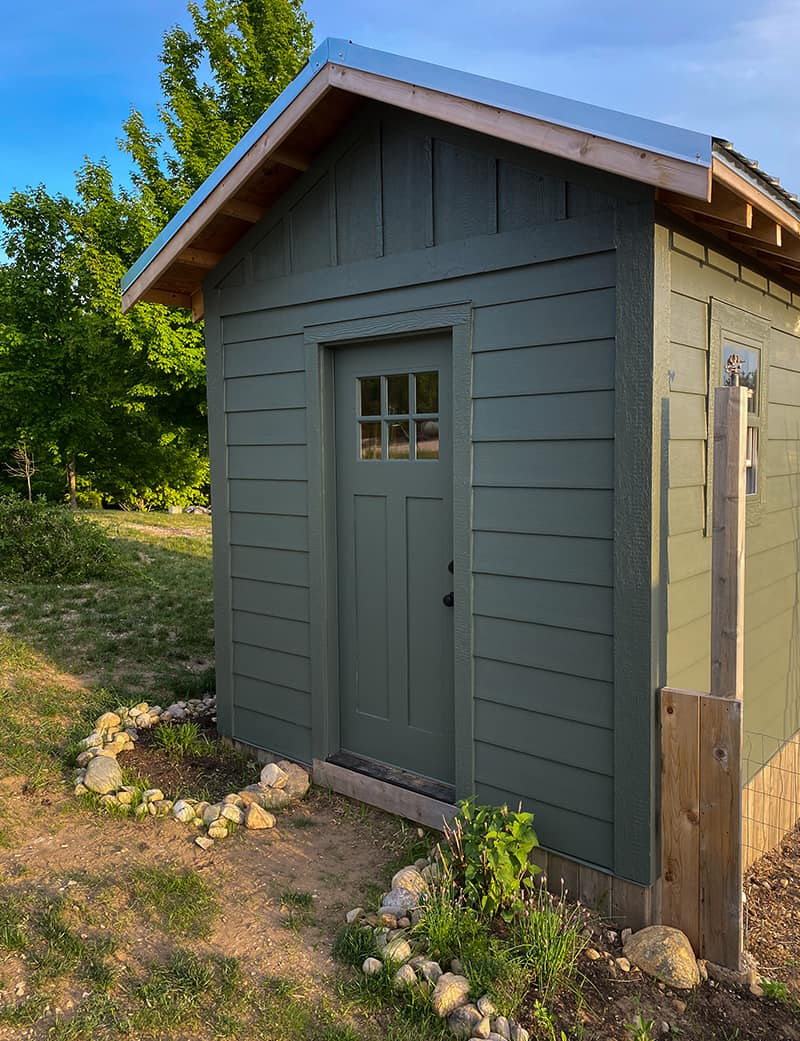 Exterior of a large chicken house with storage space