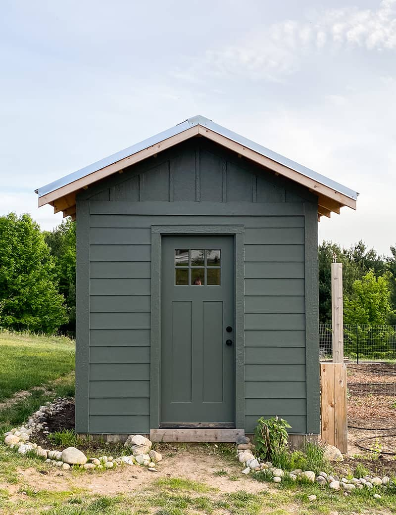 Completed Chicken Coop with board and batten in a vermilion green color
