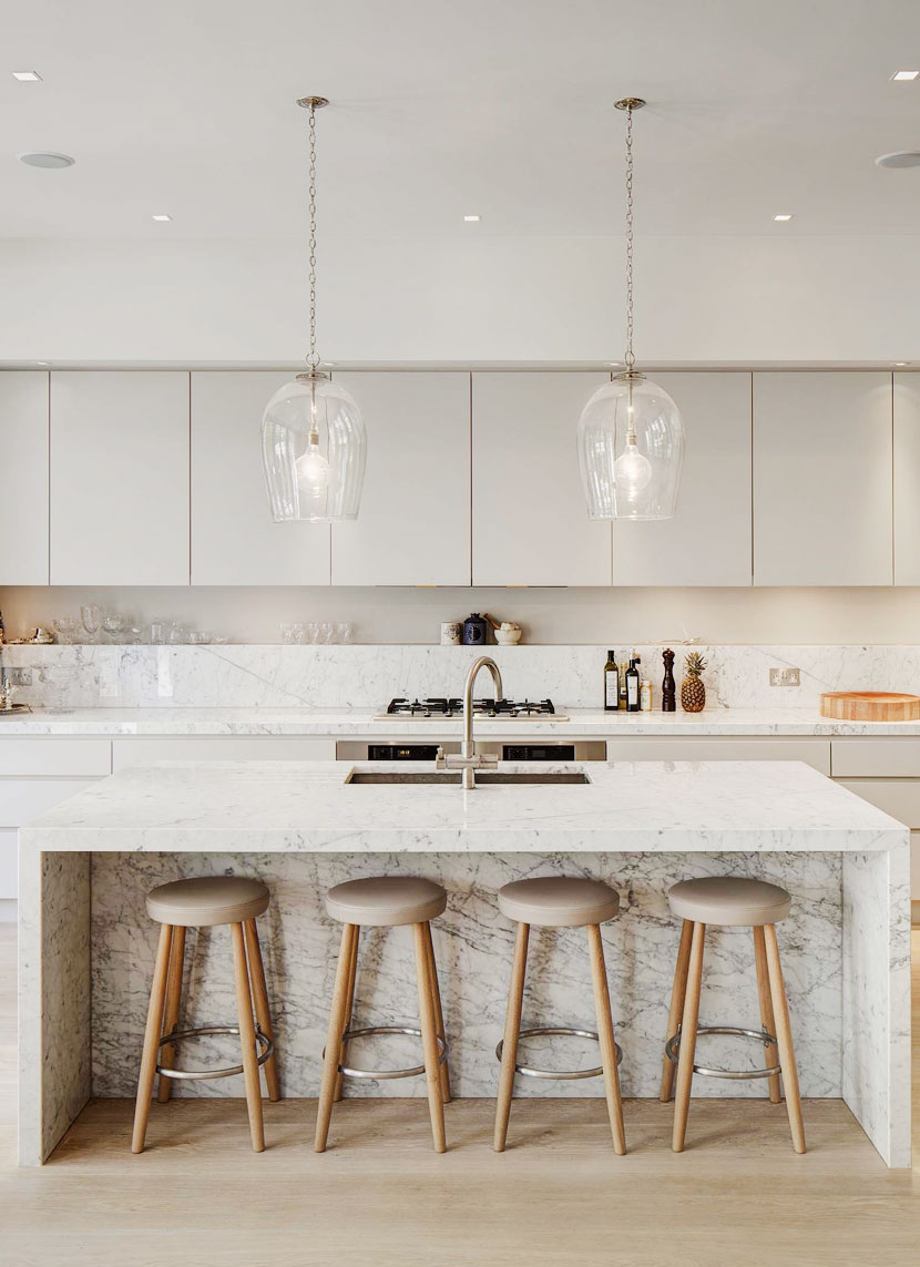 Modern Farmhouse style kitchen using minimal details and recycled tile in a neutral palette. See the full look on The Fresh Exchange.