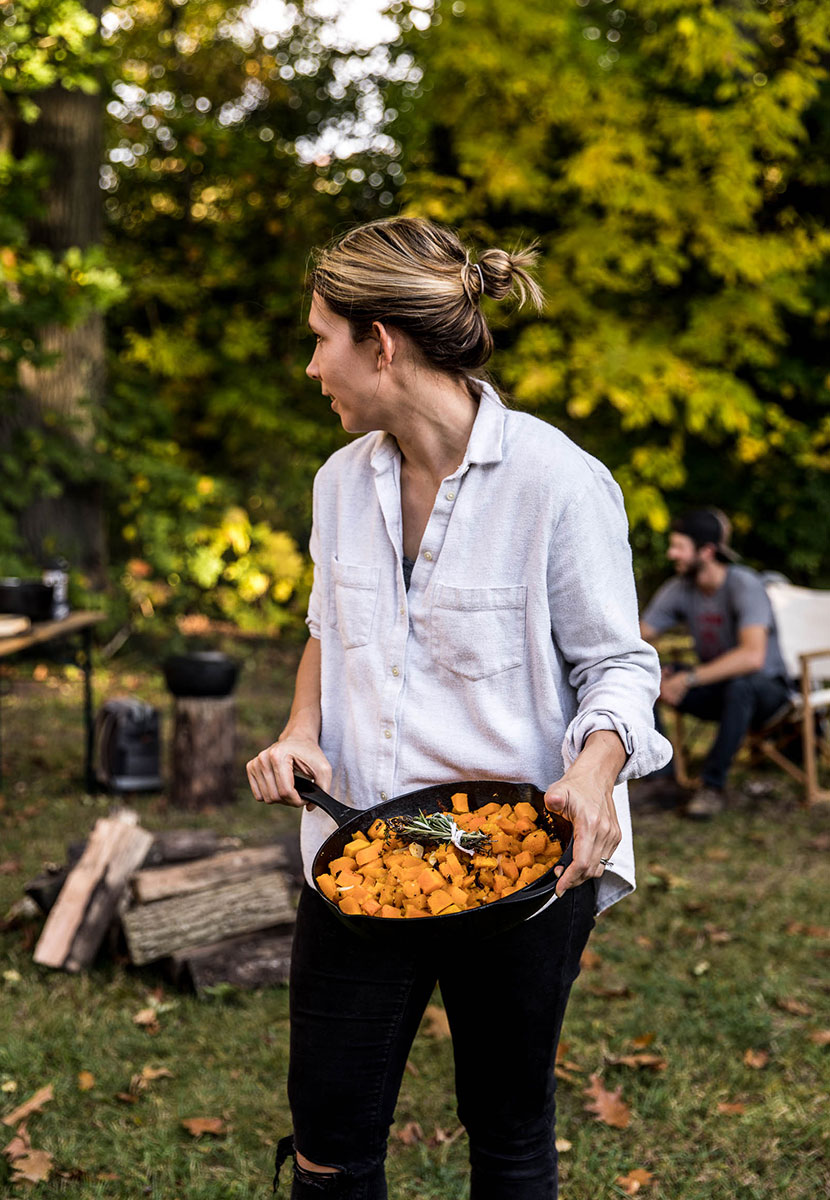 A simple outdoor fall gathering around a campfire with Barebones Living. See the full outdoor gathering on The Fresh Exchange.