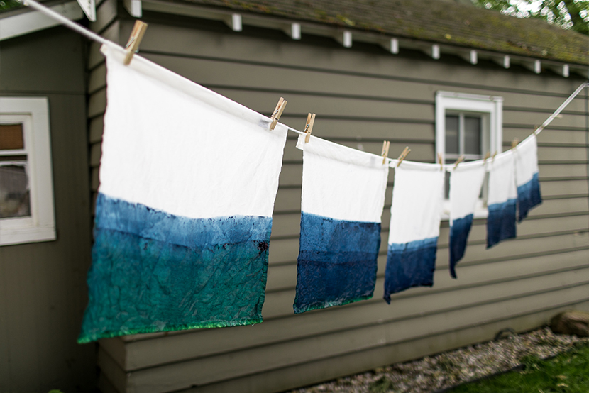 Create your own DIY Dip-Dyed Linen Napkins that look like water. Perfect for summer gatherings and a fun project for a wedding shower or baby shower with friends. Make them easily using this DIY from The Fresh Exchange.