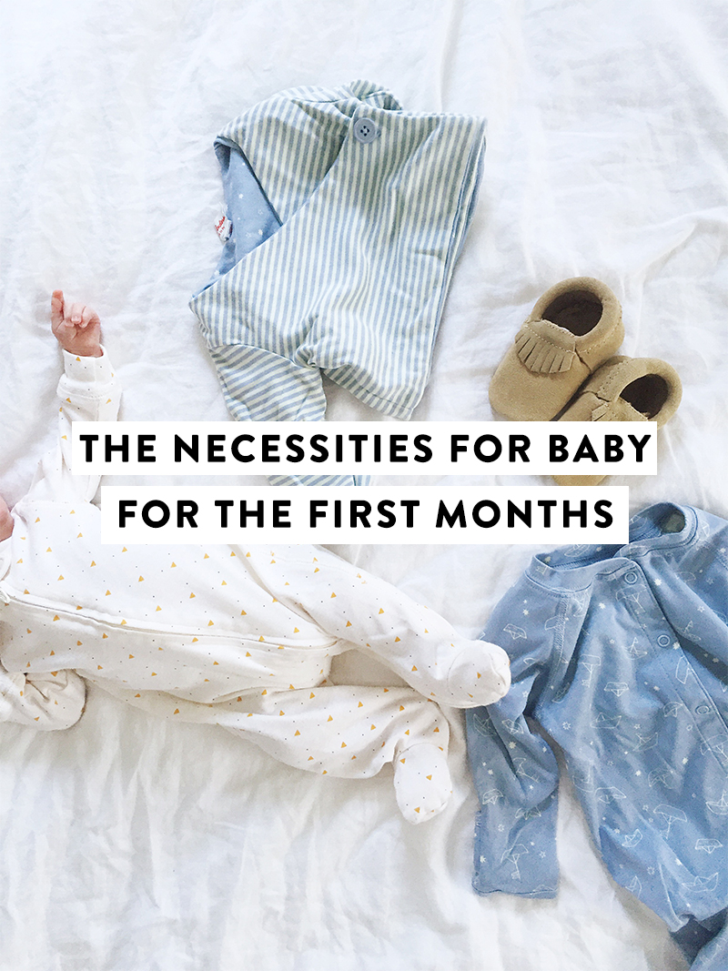 baby with graphic with clothes on bed