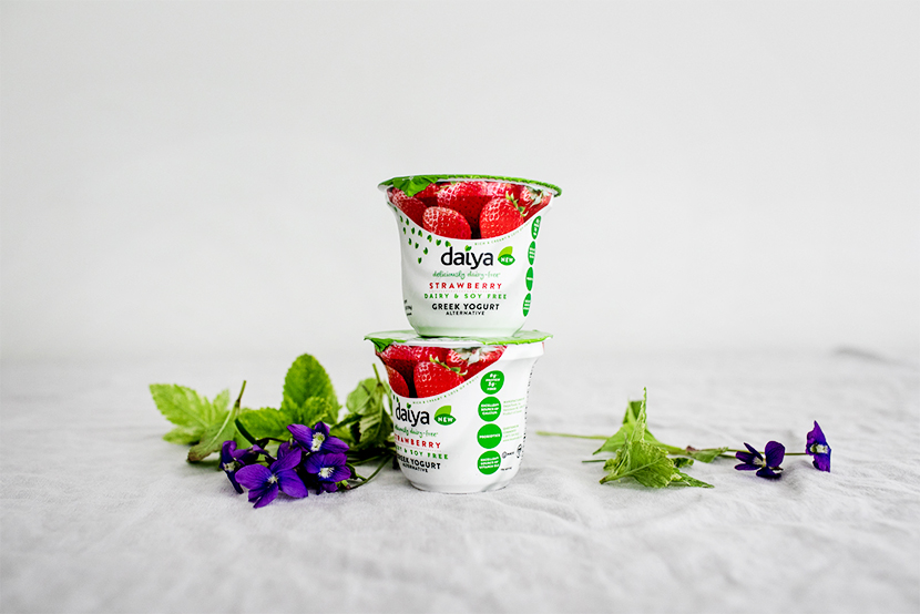 The perfect Vegan summer dessert. A Strawberry vegan frozen cake covered in wild mint and foraged violets. Made in partnership with Daiya. Get the full recipe on The Fresh Exchange.