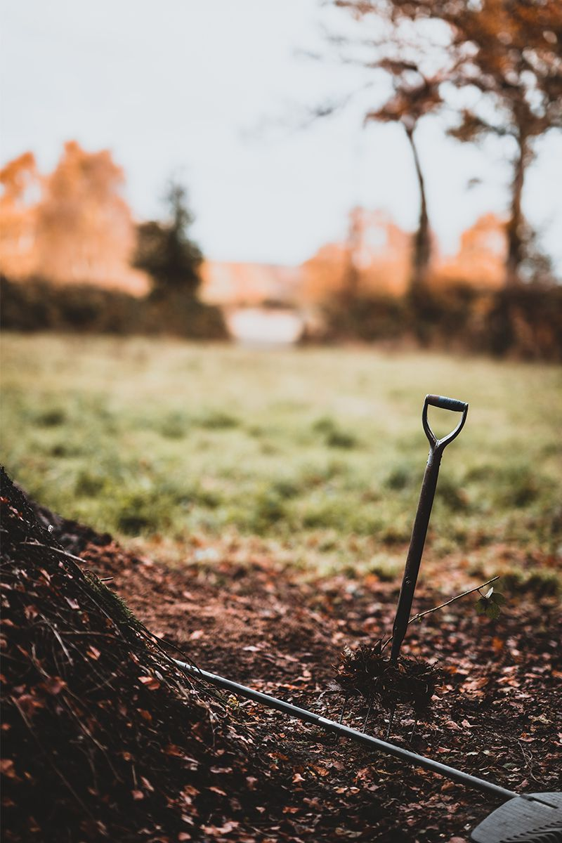 gardening with compost - a shovel on the ground