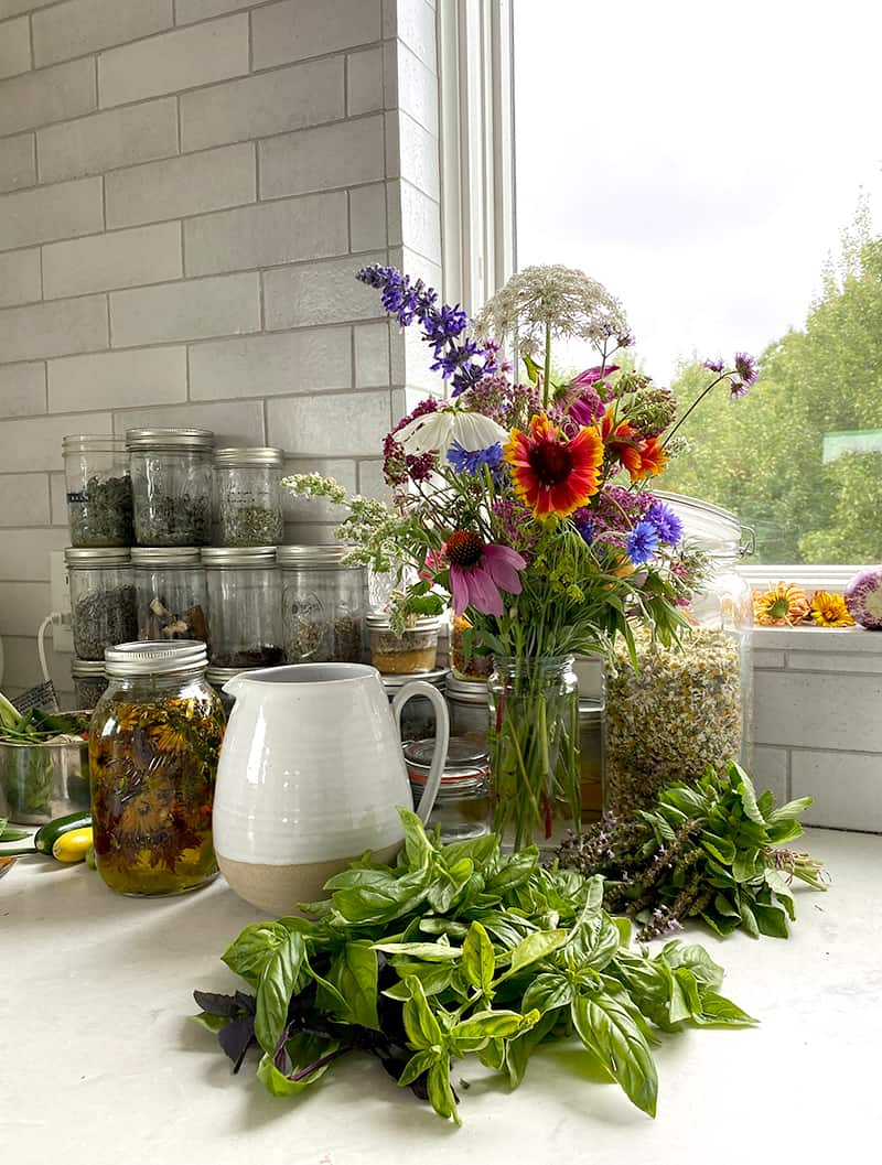 Image of Kitchen with flowers and fresh basil on counter