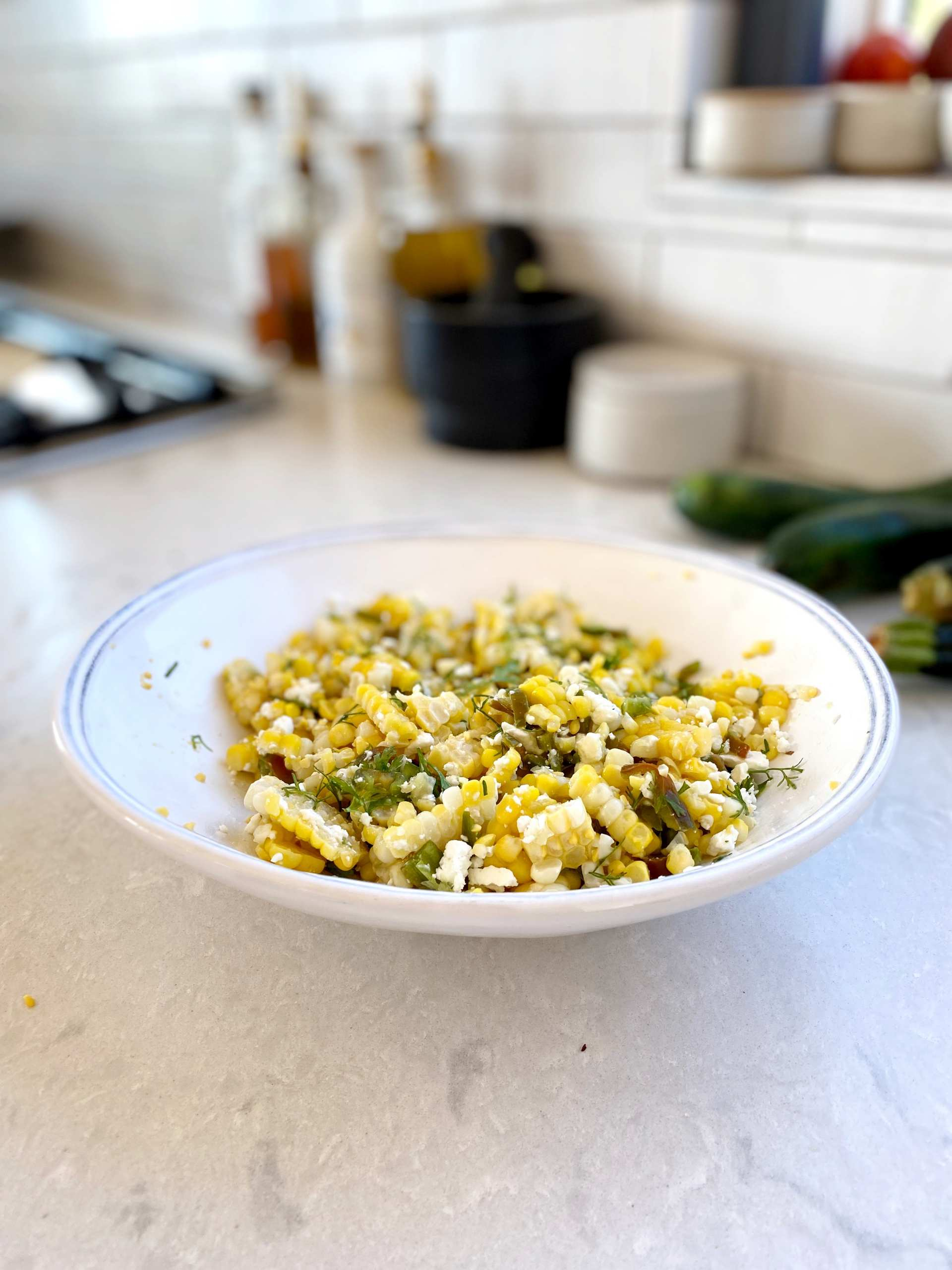 Healthy Grilled Corn Salad - a bowl of grilled corn corn salad with different toppings