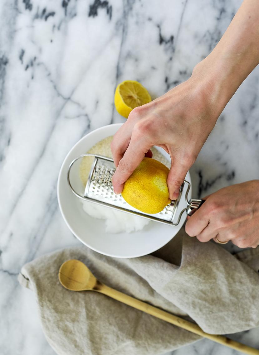 squeezing fresh lemon juice into the brightening body scrub recipe