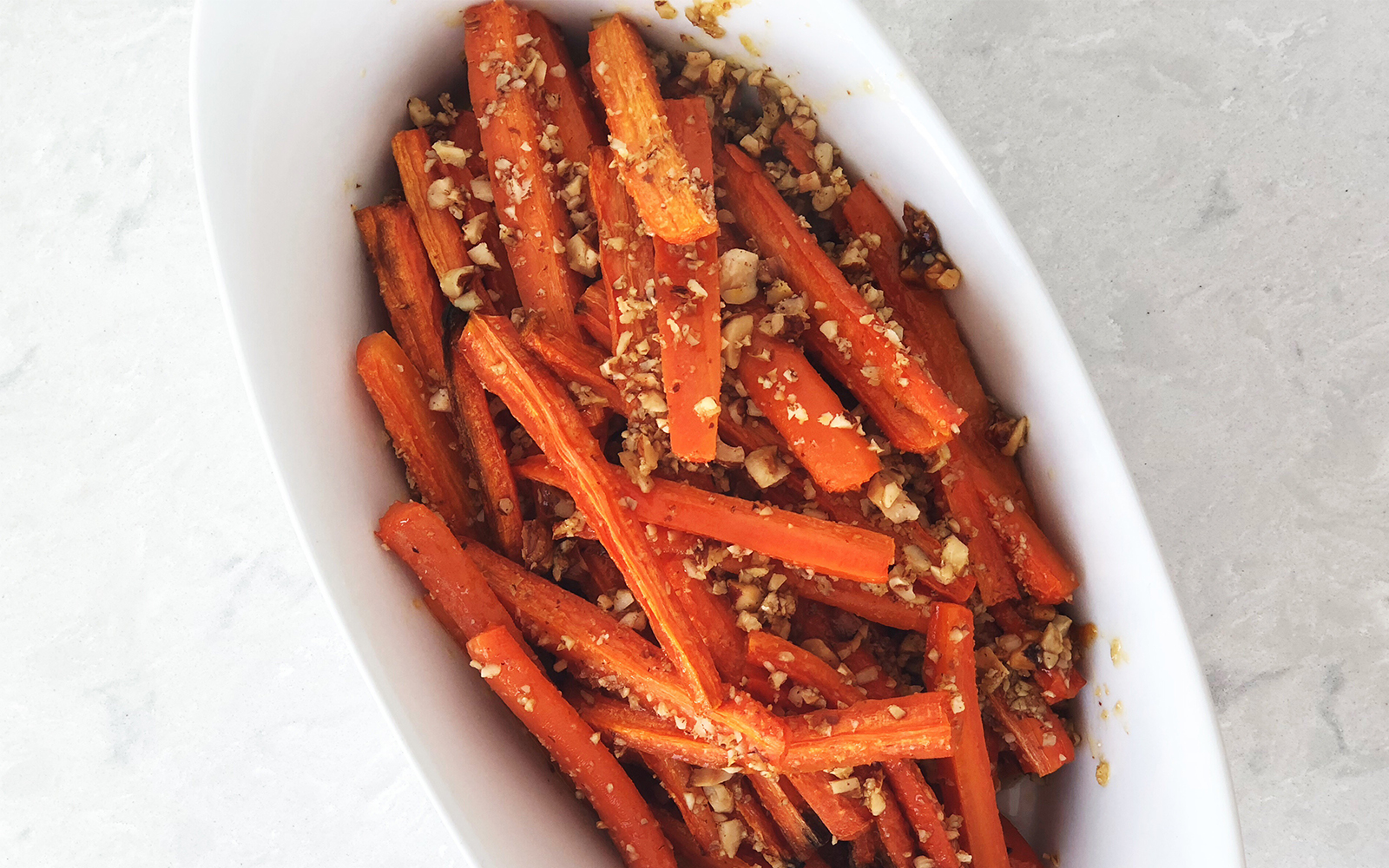 Seasonal Recipes for winter and early spring on The Fresh Exchange. Carrots roasted with butter honey and hazelnuts.