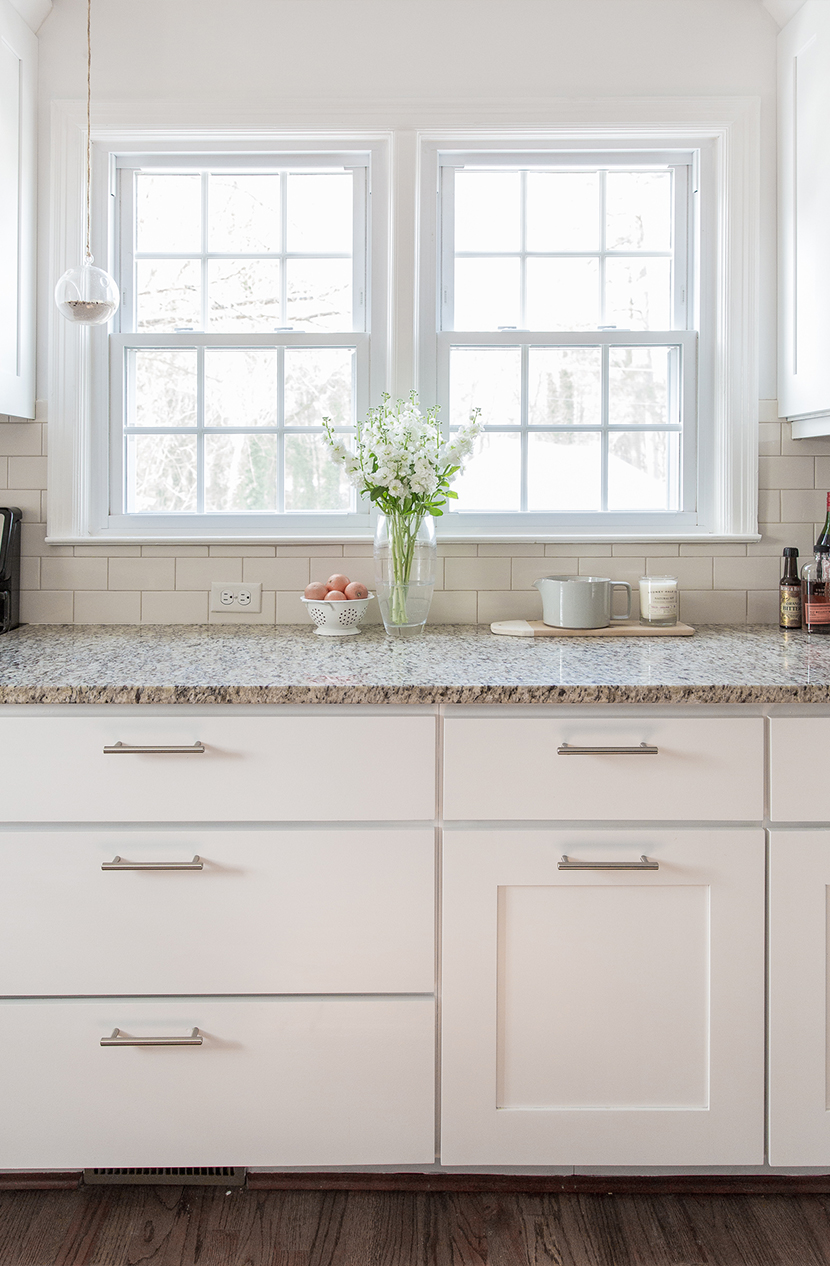 Freshly painting kitchen cabinets white without any other changes