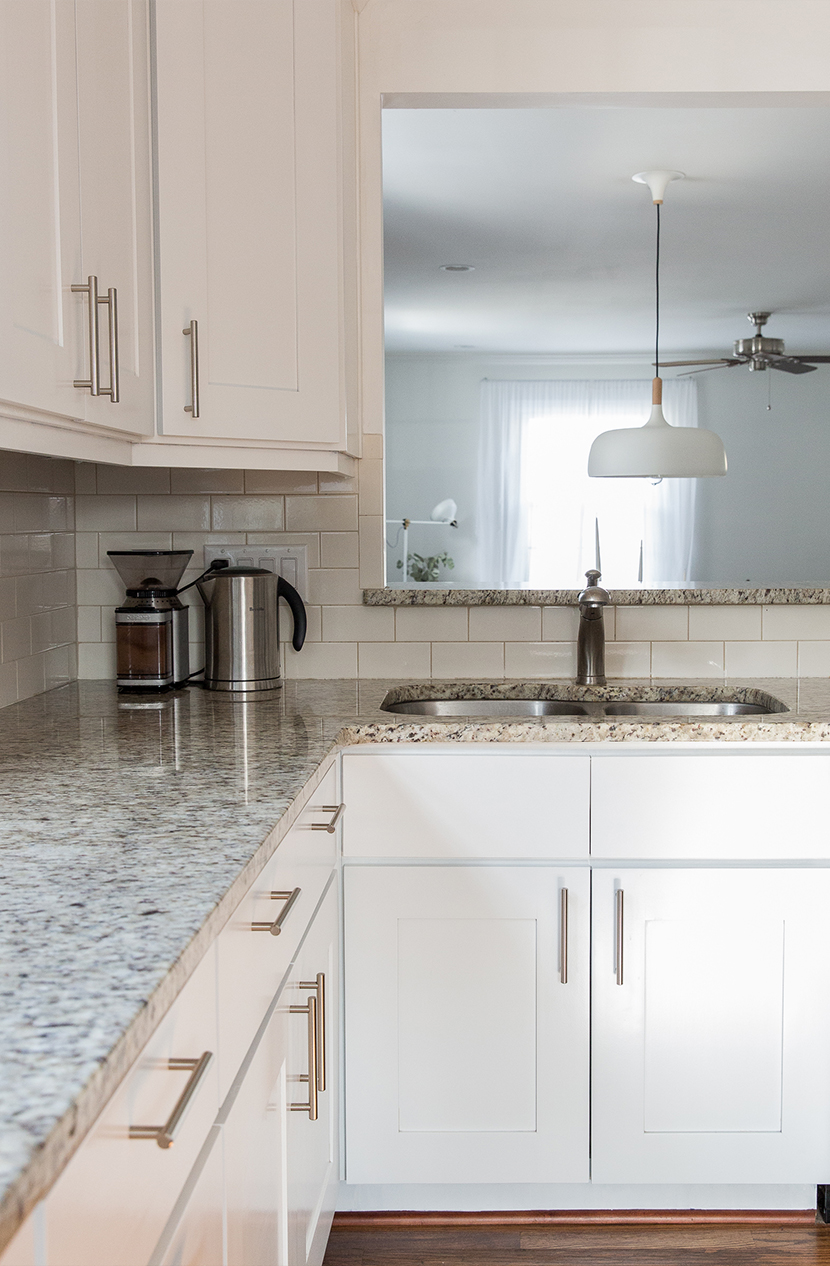 Modern white cabinets with granite countertops