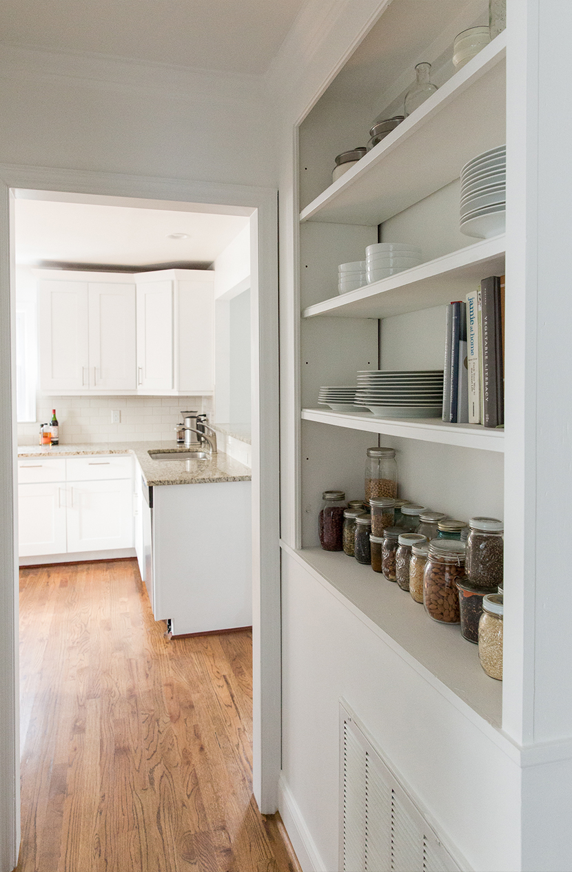 open shelving in hall way painted white