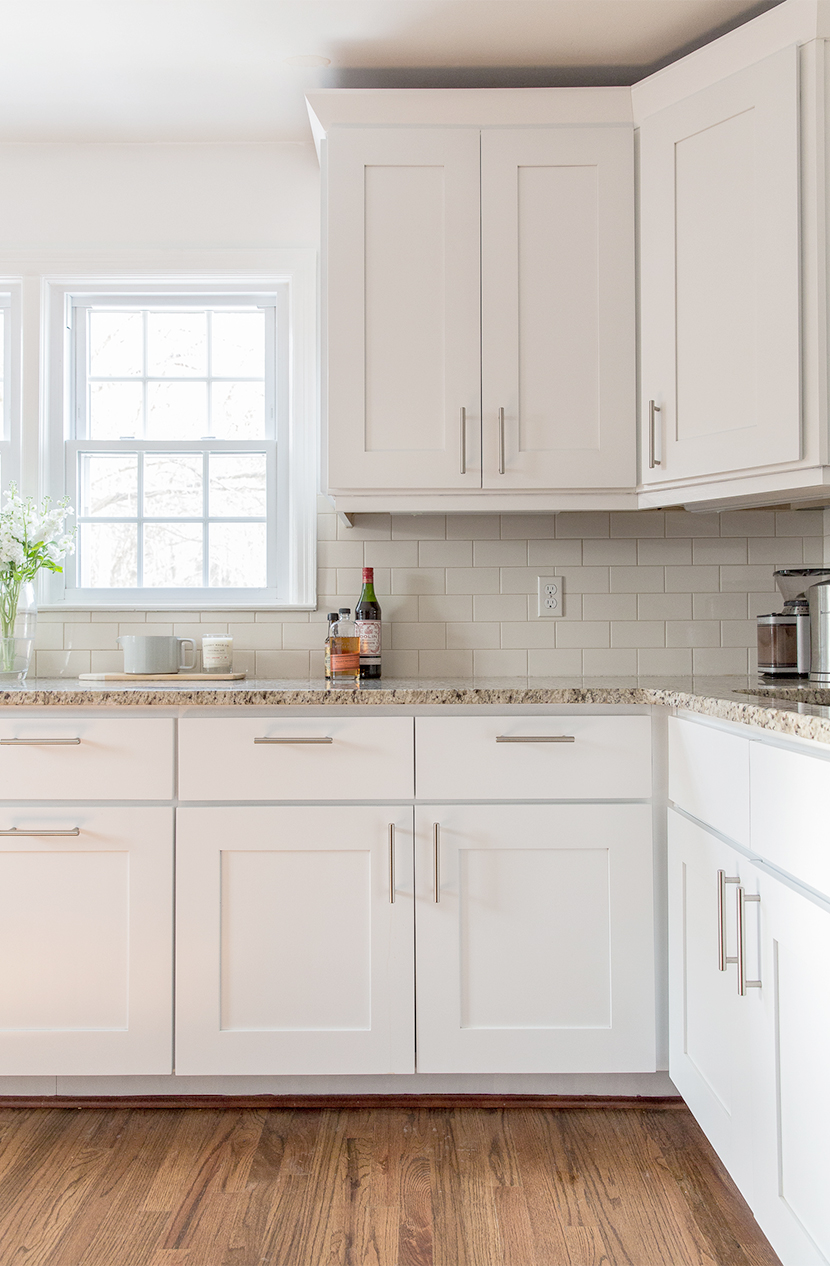 simple modern white kitchen cabinets with white tile