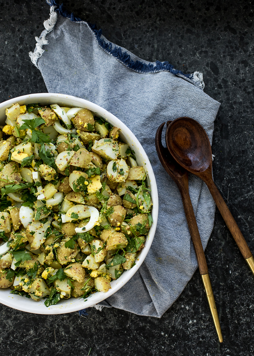 A Spring Herb Potato Salad that is Vegetarian. Perfect for Spring Gatherings. Get the Recipe on The Fresh Exchange.