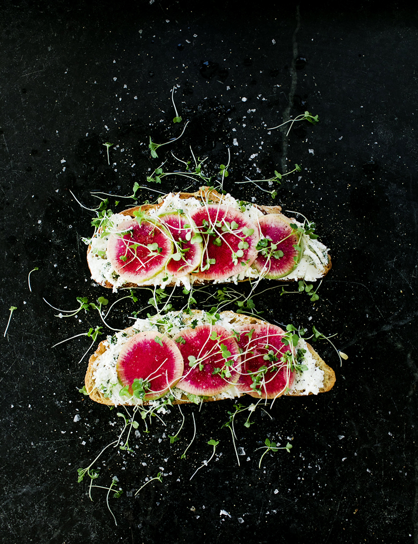 A Simple Spring Toast Recipe of Watermelon Radish and Herbed Goat Cheese. Get the full recipe on The Fresh Exchange.